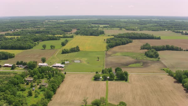 Aerial shot of a rural area with farmlands Rights-managed stock video