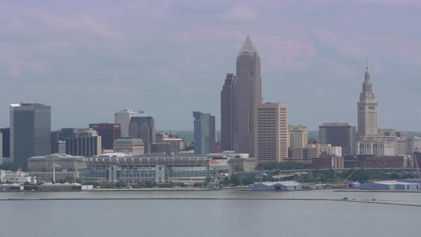 Aerial shot of Cleveland skyline seen from above Lake Erie. First Energy Stadium and the Rock and Roll Hall of Fame are visible Rights-managed stock video