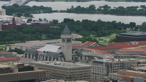 Aerial shot of the Old Post Office Tower in Washington DC, with the Washington Monument in the background Rights-managed stock video
