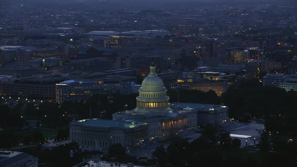 Aerial shot of illuminated United States Capitol at dusk Rights-managed stock video