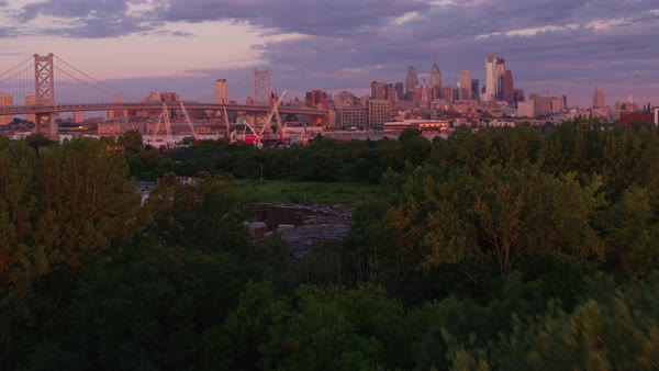 Aerial shot of skyline of downtown Philadelphia with Benjamin Franklin Bridge Rights-managed stock video