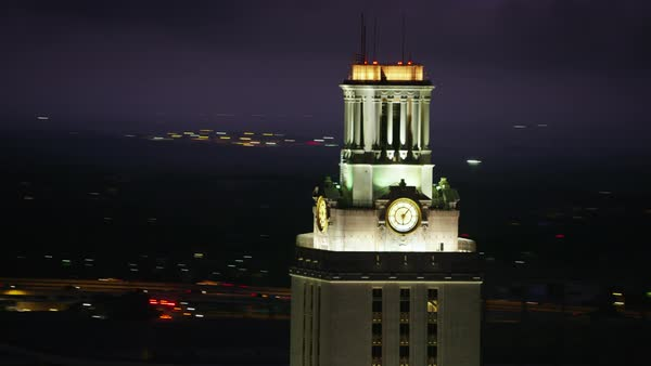 University of Texas tower building with cityscape at night Rights-managed stock video