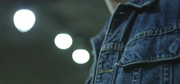 Hand-held shot of a man wearing a denim jacket Royalty-free stock video