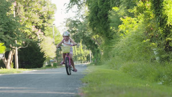 Slow motion shot of a girl riding a pink bicycle Royalty-free stock video
