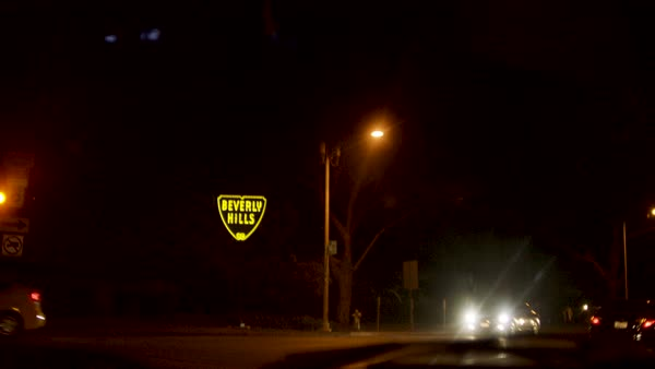 Driving past Beverly Hills sign at night Royalty-free stock video