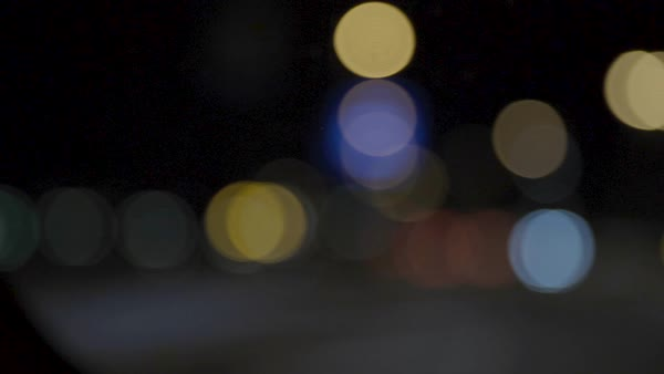Out of focus shot of blurred city lights of Tokyo from a car at night Royalty-free stock video