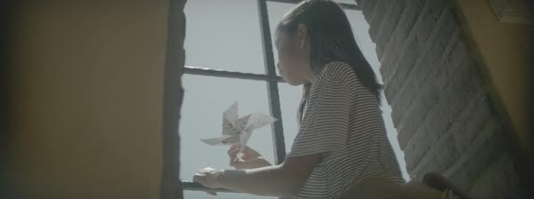 Hand-held shot of a girl playing with a pinwheel Royalty-free stock video