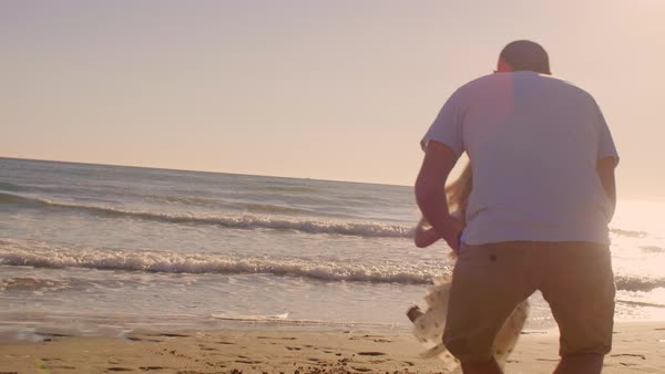 Father and daughter twirling on beach Royalty-free stock video