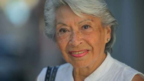 Close up shot of an old Spanish lady looking into the camera and smiling Royalty-free stock video
