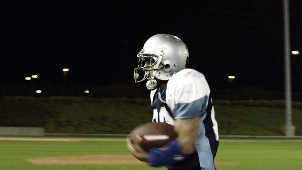 A lone football player is running down the field with the ball and scores Royalty-free stock video