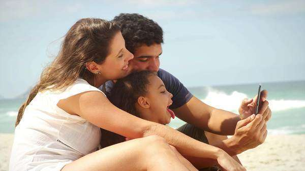 Family takes a selfie on a beach in Brazil Royalty-free stock video
