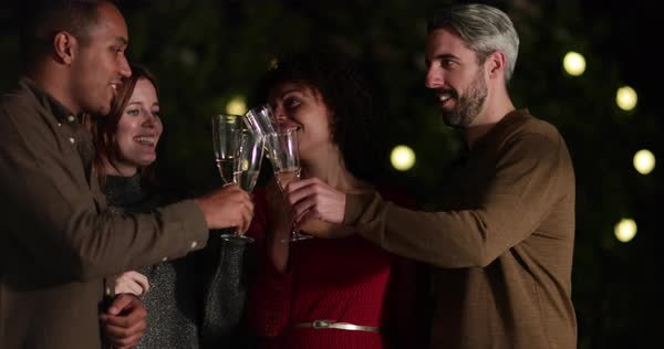 Friends drinking champagne outdoors at night Royalty-free stock video
