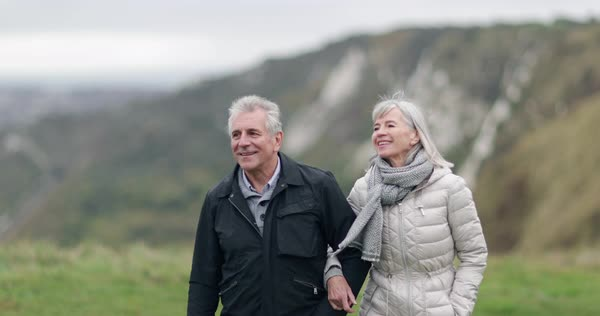 Senior couple walking outdoors Royalty-free stock video