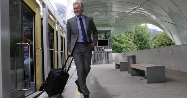 Businessman arriving at airport on shuttle train Royalty-free stock video