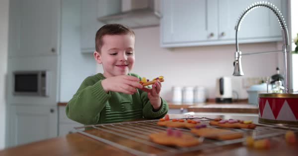 Boy eating gingerbread man Royalty-free stock video