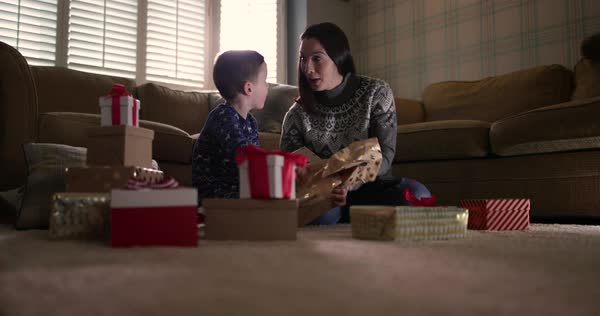 Mother and son unwrapping Christmas gifts Royalty-free stock video