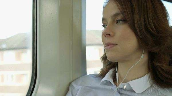Business Woman looks out at the view from the train, close-up Royalty-free stock video