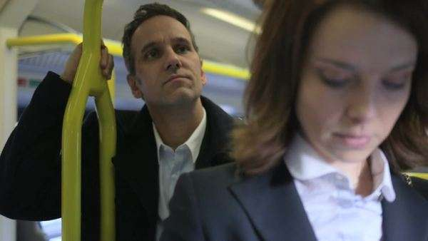Business Man and Woman travel to the city on a train, close-up Royalty-free stock video