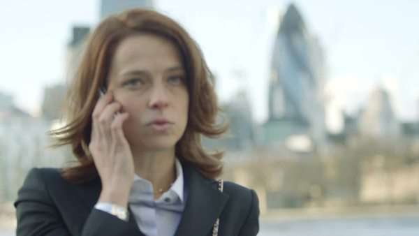 Business Woman makes a Business call by the River Thames, close-up Royalty-free stock video