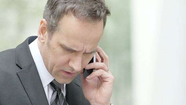 Business man receives a call, medium shot Royalty-free stock video