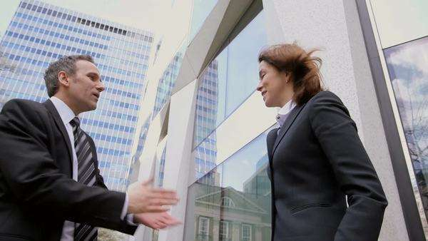 Low Angle Medium shot of Business Man and Business Woman Meeting each other Royalty-free stock video