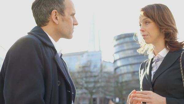 Business man and woman discuss plans in the city, medium shot Royalty-free stock video
