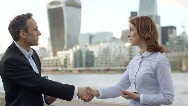 Business man and woman meet and greet each other, medium shot Royalty-free stock video