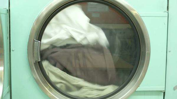 A Washing Machine spins laundry, medium shot Royalty-free stock video