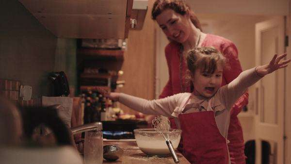 Mother assisting daughter to mix dough in bowl while making pancake Royalty-free stock video