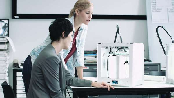 Team woman designers looking at 3D printed object Royalty-free stock video