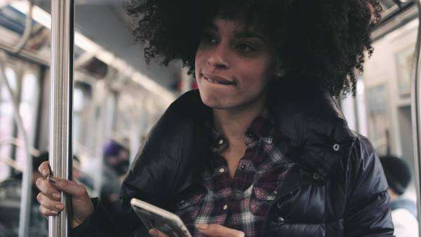 Young woman on subway with smart phone Royalty-free stock video