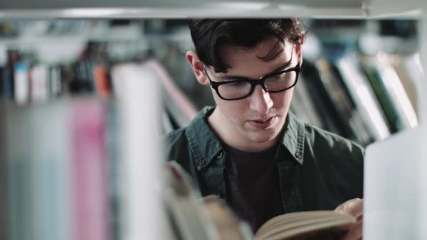 Student reading in a library Royalty-free stock video