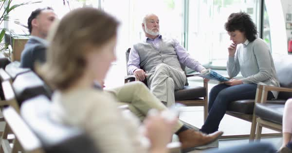 Senior male waiting in a crowded hospital waiting room  Royalty-free stock video