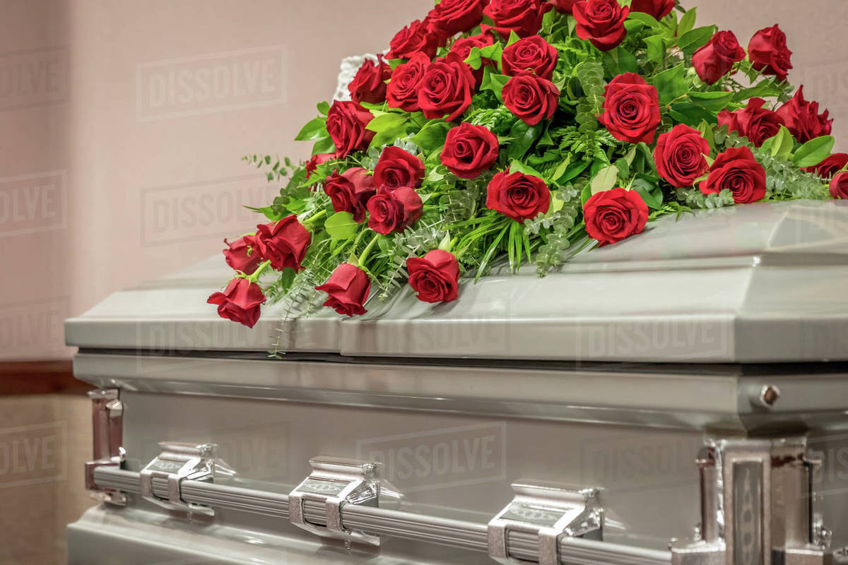 Roses on Top of Funeral Casket Royalty-free stock photo