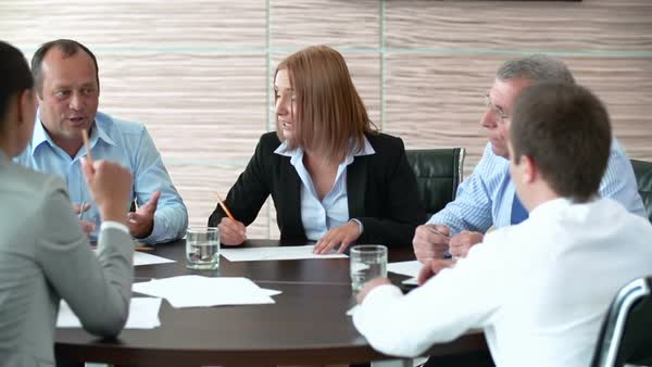 Pan of business people brainstorming at round table Royalty-free stock video