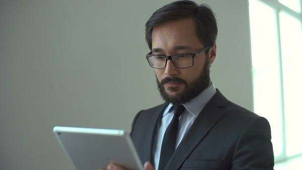 Close up of businessman looking at touchpad screen and smiling Royalty-free stock video