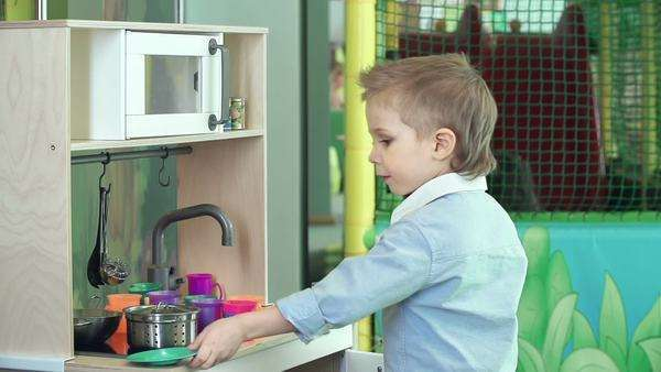 Side View Of Little Boy Cooking In Play Kitchen Set Stock Video