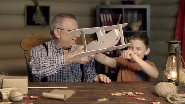 Kid playing with DIY model airplane made by his grandfather  Royalty-free stock video