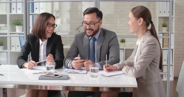 Group of smiling business people discussing ideas in team meeting Royalty-free stock video