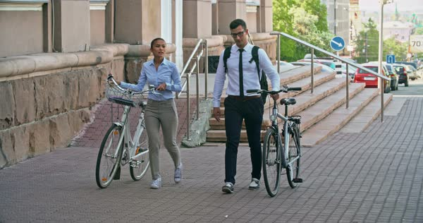 Office workers walking with bicycles from work  Royalty-free stock video