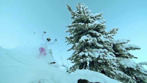 Low angle view of skier jumping from the hill and landing in cloud of snow dust Royalty-free stock video