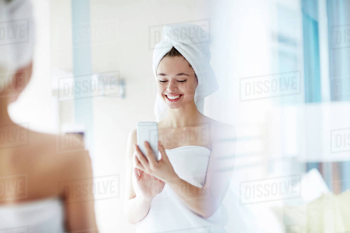 Girl With Cellphone Making Selfie In Front Of Mirror Stock Photo