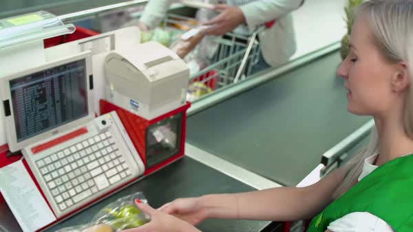 Focus on cash register screen and keyboard, cashier ringing items through Royalty-free stock video