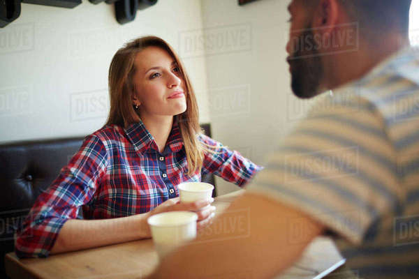 Young woman looknig at her boyfriend in cafe Royalty-free stock photo