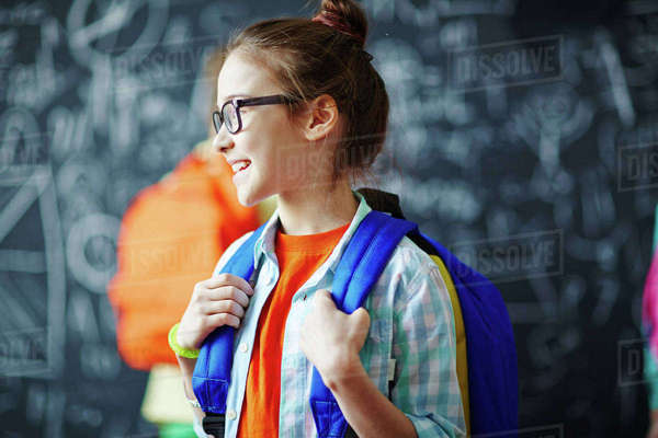 Happy schoolgirl with blue backpack Royalty-free stock photo