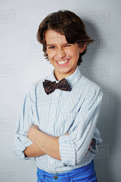 Cheerful boy with toothy smile winking Royalty-free stock photo