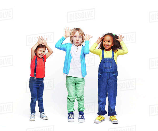 Funny kids in casual-wear making faces Royalty-free stock photo