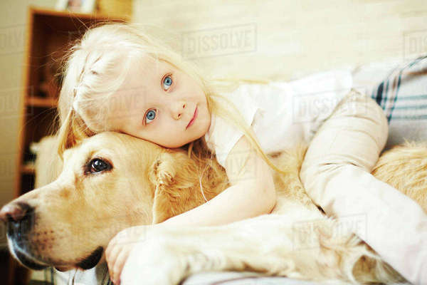 Adorable girl embracing her pet Royalty-free stock photo