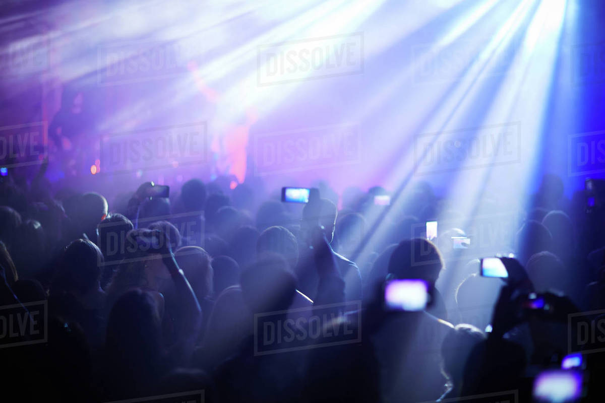 Person in crowd at concert recording with smartphone Royalty-free stock photo