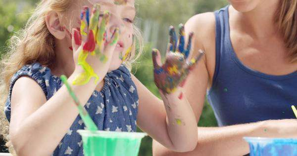 Happy family with little girl painting in the yard Royalty-free stock video